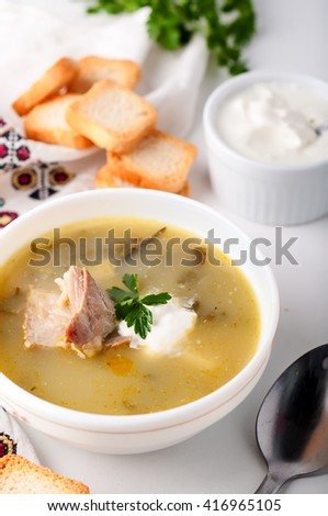 Delicious green soup with sorrel on table  - stock photo