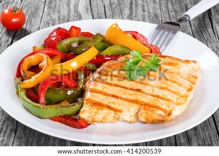 Delicious Grilled Chicken breast fillet and fried bell pepper, close-up - stock photo