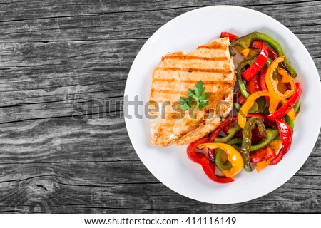 Delicious Grilled Chicken breast fillet and fried bell pepper , horizontal top view - stock photo