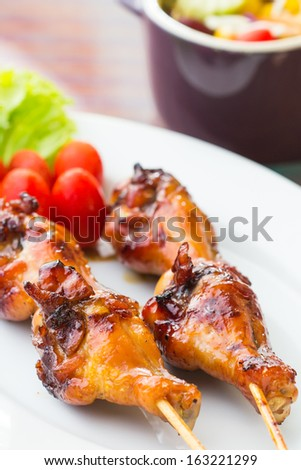 Delicious grilled chicken on a white plate.