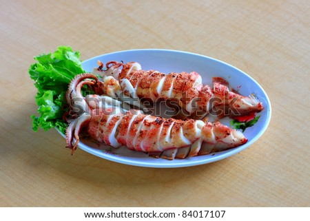 Delicious grilled squids - stock photo