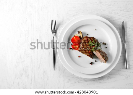 Delicious grilled steak on plate - stock photo
