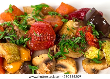 Delicious grilled vegetables with minced herbs and garlic. Macro. Photo can be used as a whole background. - stock photo