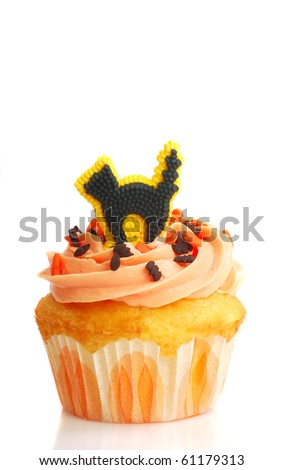 Delicious Halloween cupcake with butter cream frosting and a black cat candy - stock photo