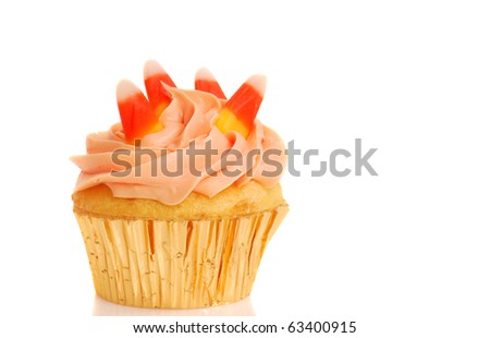 Delicious Halloween cupcake with butter cream frosting and candy corn - stock photo