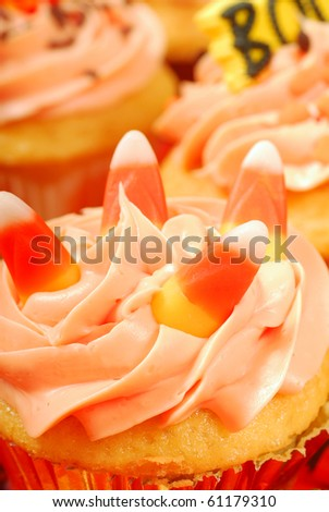Delicious Halloween cupcakes presented on a serving tray - stock photo
