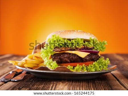 Delicious hamburger on wood - stock photo