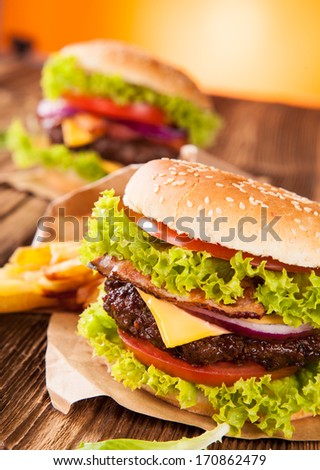 Delicious hamburger on wood - stock photo