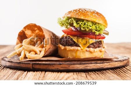 Delicious hamburger served on wood. Isolated on white background - stock photo