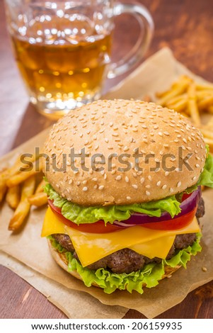 Delicious Hamburger with French Fries and Beer - stock photo