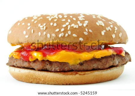 Delicious hamburger with lots of cheddar - stock photo