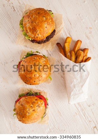Delicious hamburgers served on wooden planks. Shot from aerial view - stock photo