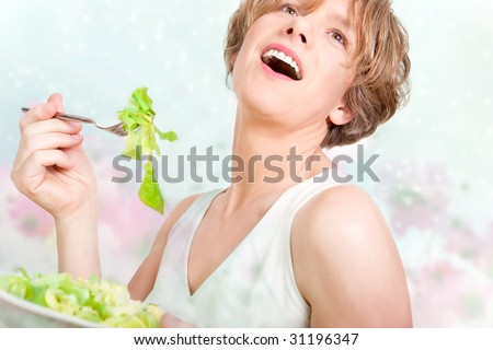 Delicious! - happy woman eating salad - stock photo