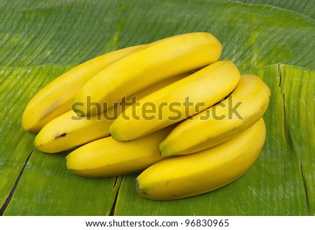delicious healthy fresh yellow banana on leaf - stock photo