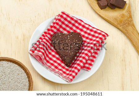 Delicious healthy homemade dark chocolate chia seed almond flour love heart cookie snack - stock photo