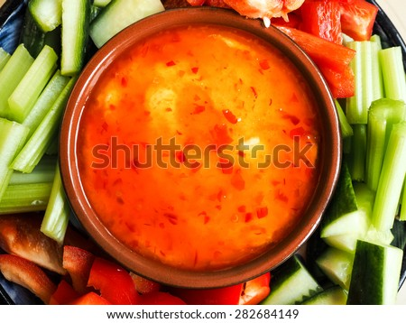 Delicious healthy salad on plate with dressing - stock photo
