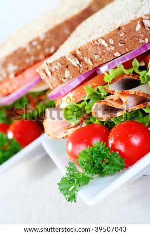 delicious healthy wholegrain sandwich with lean turkey and healthy vegetables, narrow focus - stock photo