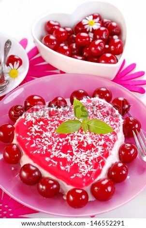 delicious heart shape cherry cake with mascarpone cheese and jelly - stock photo