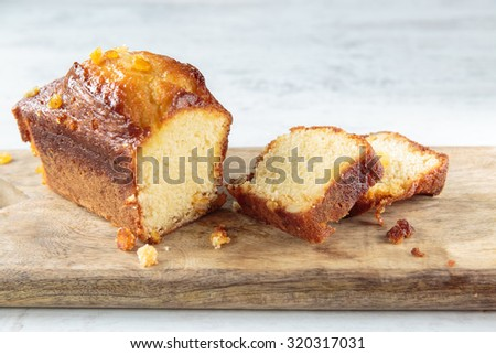 Delicious hoe made orange cake on a chopping board