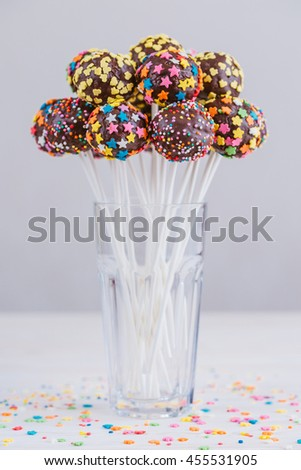 Delicious holiday colored cake pops - stock photo