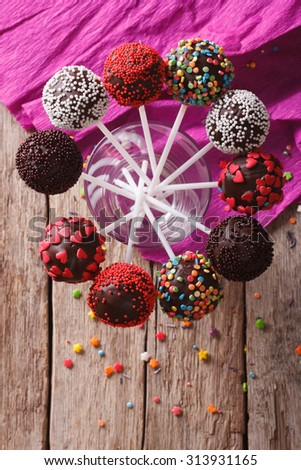 Delicious holiday colored cake pops in a glass. vertical top view