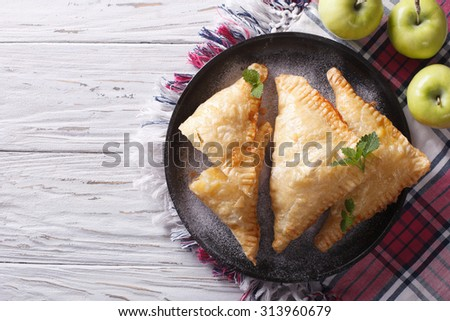 Delicious homemade apple pie turnover on a plate. horizontal view from above