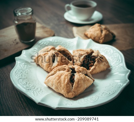 Delicious homemade apple strudel on wooden background. Toned picture - stock photo
