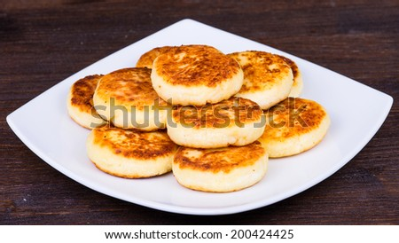Delicious homemade cheese pancakes on white plate, close up - stock photo