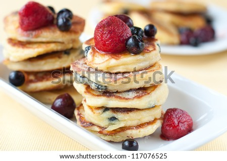 Delicious homemade cheese pancakes with berries - stock photo