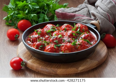 Delicious homemade chicken or turkey meatballs with rice, vegetable in tomato sauce/Meatballs in tomato sauce  - stock photo