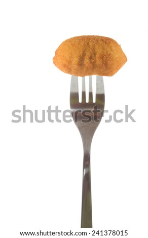 Delicious homemade croquette pricked on a fork on white background - stock photo