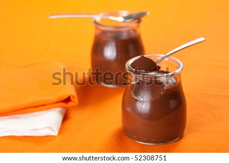 delicious homemade dessert chocolate mousse in glass jar - stock photo