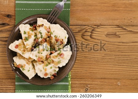 Delicious homemade dumplings with onion and bacon - stock photo