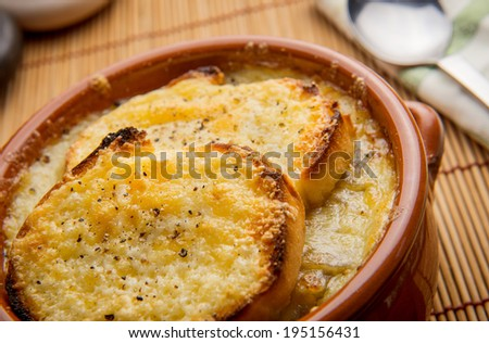 Delicious homemade French onion Soup with cheesy croutons - stock photo