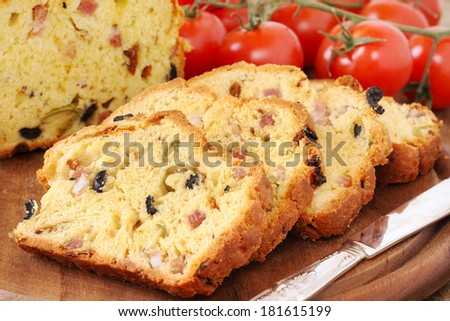 Delicious homemade freshly baked olive and bacon loaf - stock photo