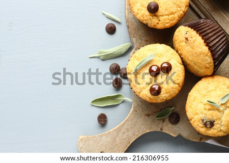 Delicious homemade gluten free muffins with chocolate drops  on wooden cutting board - stock photo