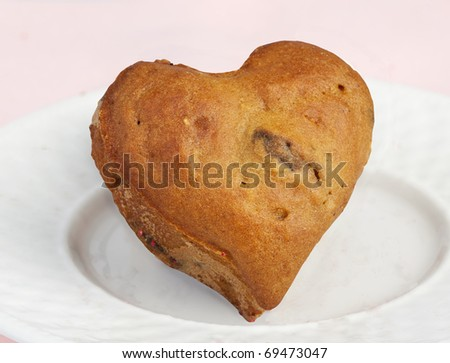 Delicious Homemade Heart Shaped Blueberry Muffin on a White Plate - stock photo