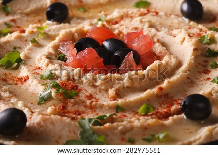 delicious homemade hummus with olives and tomatoes macro. horizontal - stock photo