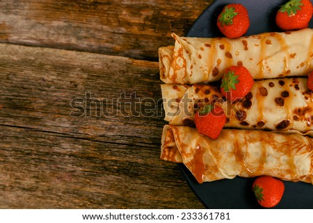 Delicious homemade pancakes on the table - stock photo