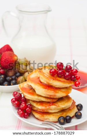 Delicious homemade pancakes with jam, fresh berries and milk