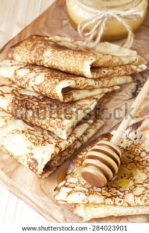 Delicious homemade pancakes with  sauce - stock photo