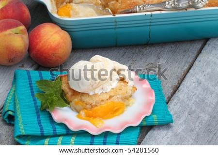 Delicious homemade peach cobbler with vanilla ice cream. - stock photo
