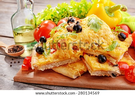 Delicious homemade pizza on table close-up - stock photo