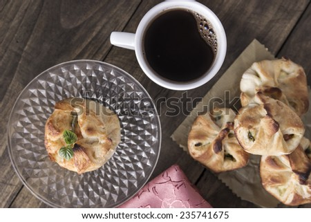 Delicious homemade  strudel with coffee on wooden background. - stock photo