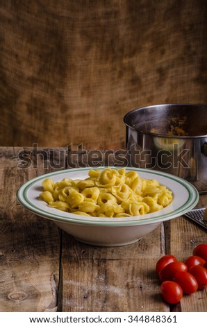 Delicious homemade tortellini from original italian hard semolina flour, place for your advertising - stock photo