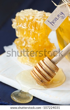 Delicious honey on a white wooden board.