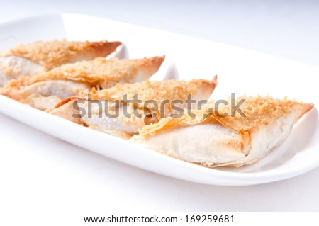 delicious hors doeuvres bite sized baked snacks - stock photo