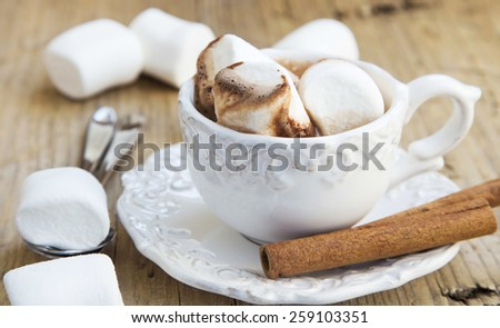 Delicious Hot Chocolate Cup with Marshmallows on Wooden Table