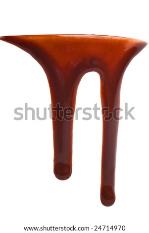 Delicious hot chocolate dripping from the edge of a cup - stock photo
