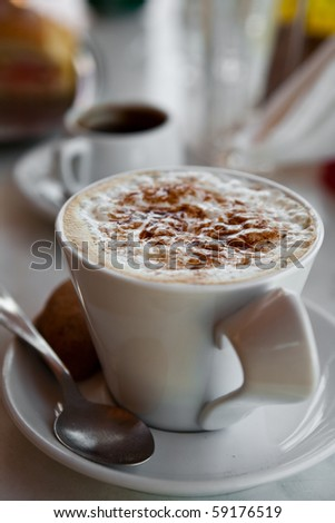 Delicious hot chocolate with cream on a breakfast table - stock photo